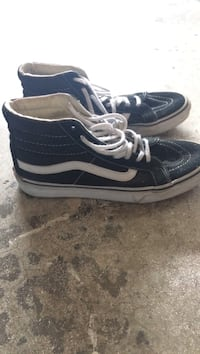 pair of black-and-white Vans Sk8-Hi sneakers