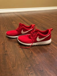 pair of red-and-white Nike sneakers