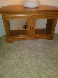 brown wooden TV stand with cabinet Colorado Springs, 80916