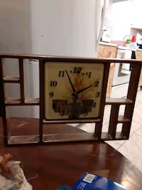 Wall clock surrounded by cubby hole's