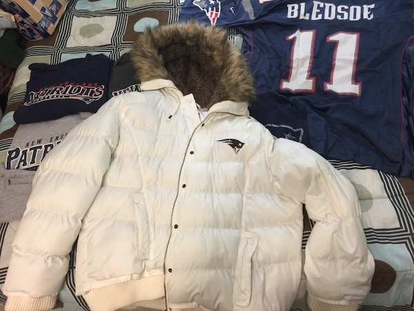 e8c2aa738 New England Patriots plush bubble jacket with fur hood.