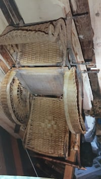 1800's antique wicker baby carriage the four carriage wheels. Glocester, 02814