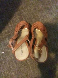 pair of brown leather sandals 616 mi