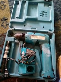 teal and black Makita corded power drill with case Santa Fe, 87505