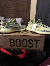 pair of white Adidas Yeezy Boost 350 V2 shoes with box