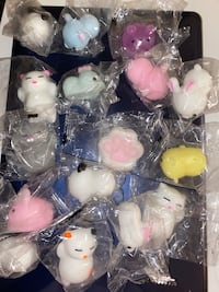 16 squishies brand new in packages