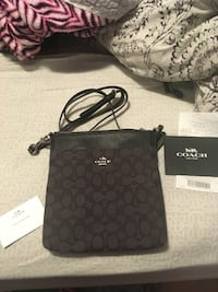 Black coach monogram sling bag