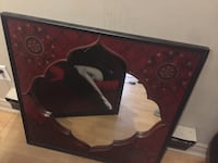 red and black wooden framed mirror