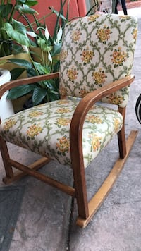 brown wooden framed brown and white floral padded chair