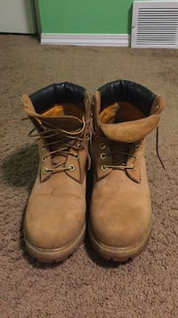 Pair of brown leather work boots Calgary, T3G 4K8