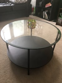 Round black metal framed glass top table Rockville, 20852