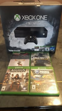 New X BOX 1 with 4 games and x box live code  Brampton, L6T 1M3