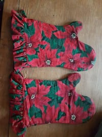 pair of red-and-green floral gloves
