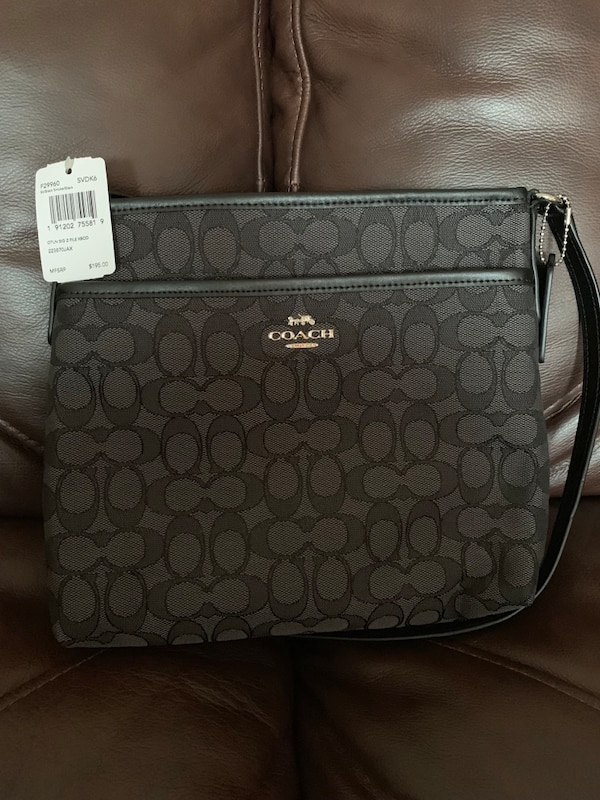 monogrammed gray and black Coach leather tote bag
