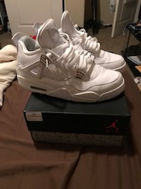 Pair of air jordan 4s with box