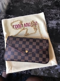 Damier Ebene Louis Vuitton leather wallet Edmonton, T5G 1X5