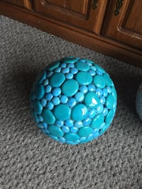 Garden ball hand made from bowling bowl with stones attached this garden ball is not going to break