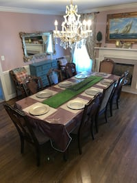 Rooms 2 Go Brown Wooden Dining Room Table, Chairs, and China Hutch