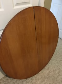 Oval brown wooden dining table Kawartha Lakes