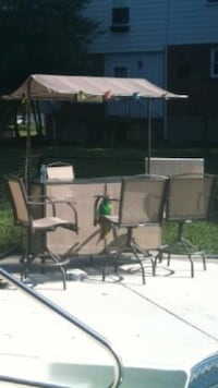 Outdoor Bar and 4 Stools with yellow cushions. Catonsville, 21228