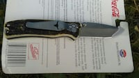 brown and stainless steel folding knife