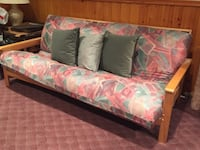Solid wood futon; barely used. Dimensions: Length: 79 inches, height: 34 inches, depth: 31 inches Toronto