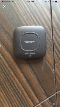 Spigen wireless charger for ya phone  Calgary, T2P 1A6