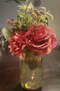Mason jar center pieces with flower arrangements Deer Park