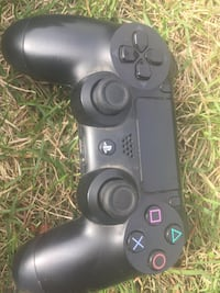 Three Black sony ps4 dualshock 4 controller