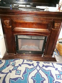 brown and black electric fireplace Vancouver, V5R 2J7