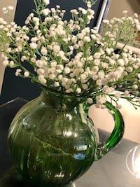 Artificial flowers in glass Pitcher  Vaughan