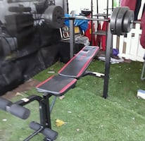 Cap weight bench with 100 lbs weights.  New, never used. Easy to assem