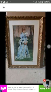 woman in white dress painting with brown wooden frame 552 km