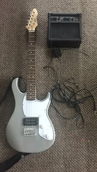 grey and white stratocaster electric guitar with black guitar amplifier New Bedford, 02740
