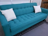 ASHLEY FURNITURE MODERN TEAL SOFA. FREE DELIVERY