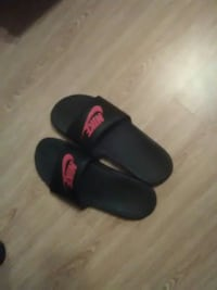 pair of red-and-black Nike slide sandals