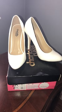 pair of white Charlotte Russe leather pointed toe pumps with box
