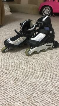 Pair of black-and-gray skates shock absorber triple fit system Fairfax, 22031