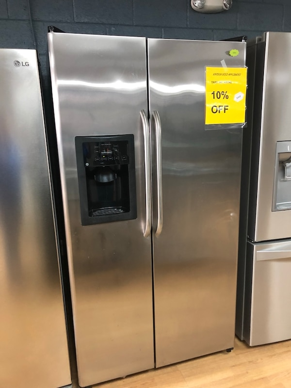 GE stainless steel side by side refrigerator  8eaf0820-e835-421c-bc9d-1dcc107aef48