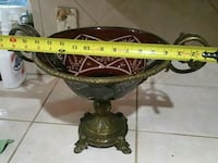 round brown and brass-color footed vase