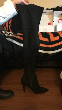 Black zip up heeled pointed toe thigh high boots