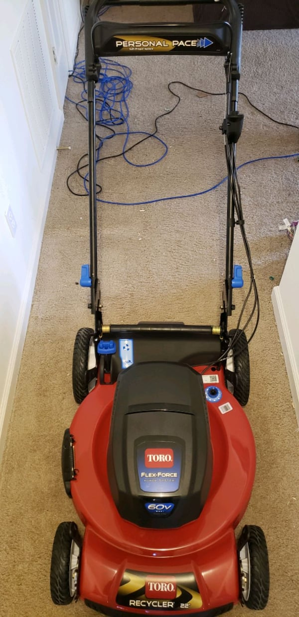 Brand new Toro 60v lawn mower with battery and charger. d0291838-d2d6-47b2-a906-c3b6f033ef16