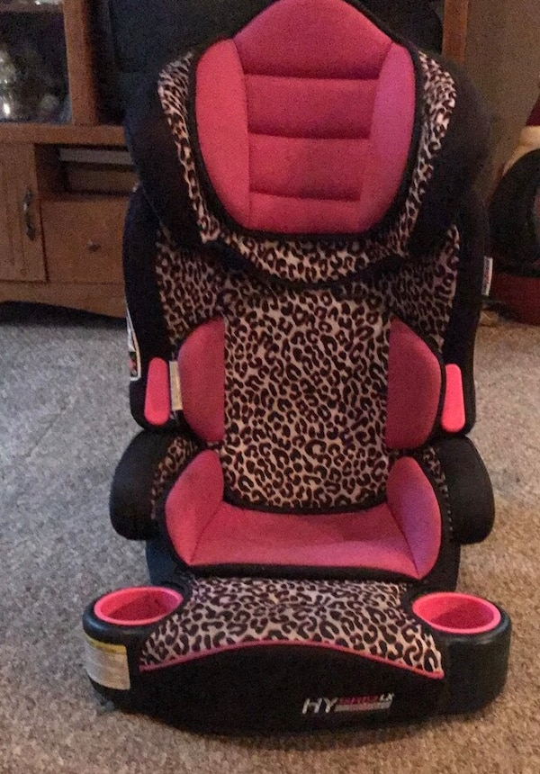 baby's black and pink car seat