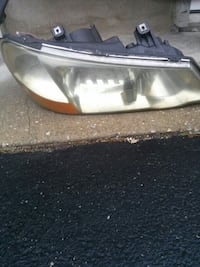2003 Aura left front headlight Catonsville, 21228