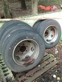 two gray bullet hole car wheels with tires Dumfries, 22026