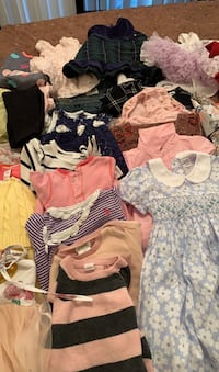 Baby girl clothes pile
