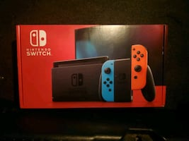 Brand New Nintendo Switch Colour Red And Blue Joy-Con
