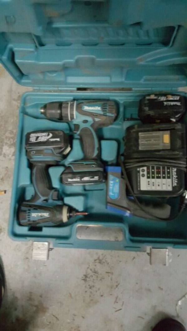 black and blue cordless hand drill in case