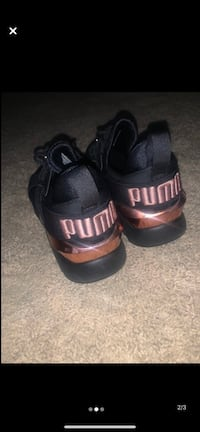 Rose gold and black pumas Clarksville, 37042