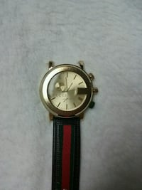 round gold-colored analog watch with black leather strap Elkhart, 46514